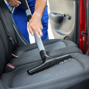 Seat being vacuumed